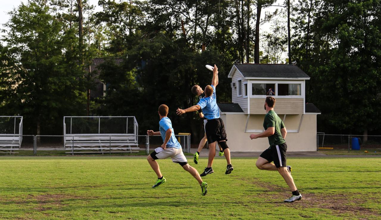 Four men playing ultimate Frisbee