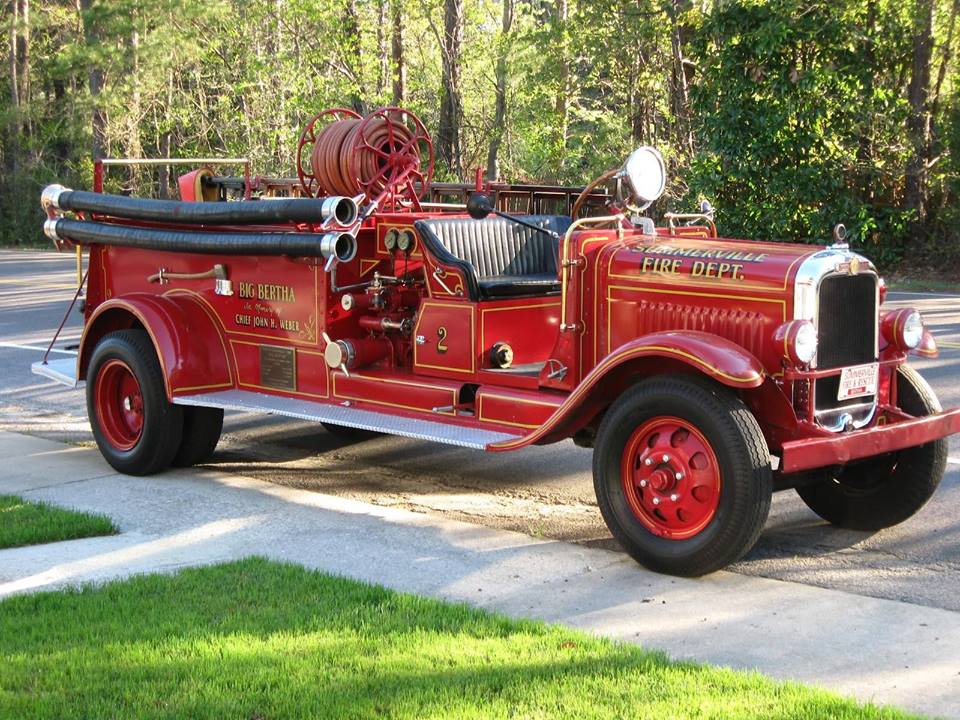 Vintage red fire truck parked